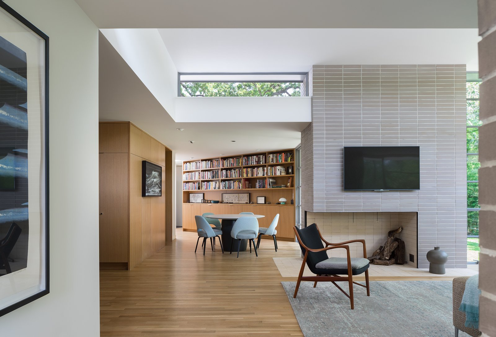 Living Room, Corner Fireplace, Recessed Lighting, and Chair  Inwood Place by Tim Cuppett Architects