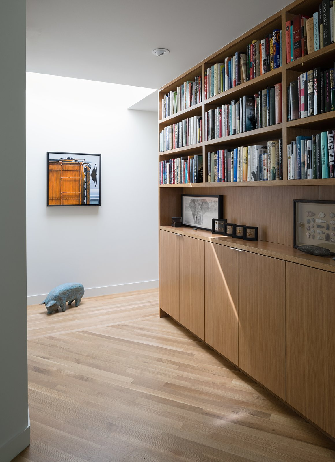 Hallway and Light Hardwood Floor  Inwood Place by Tim Cuppett Architects
