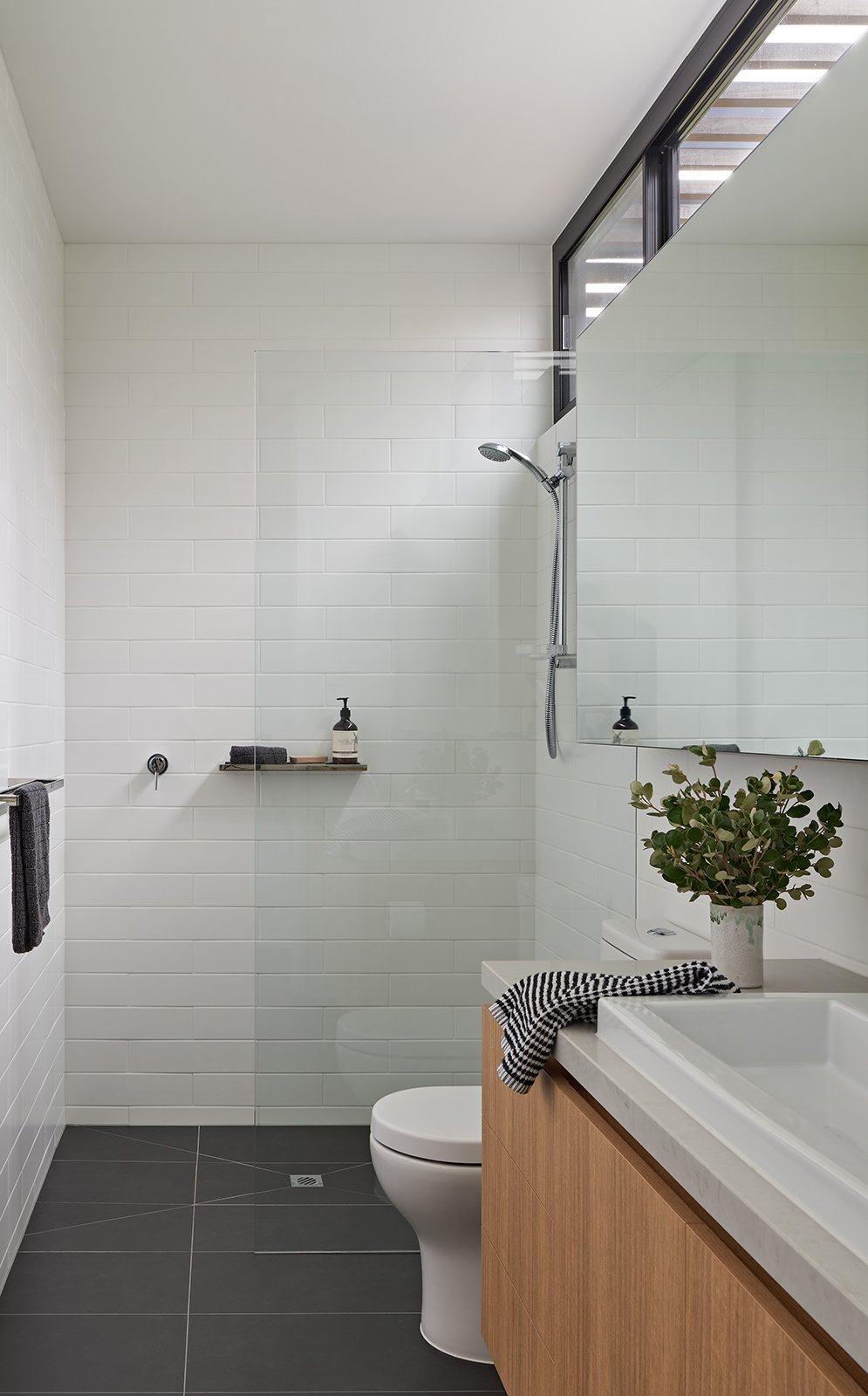 Bath Room, Subway Tile Wall, Ceramic Tile Floor, Granite Counter, Ceiling Lighting, Ceramic Tile Wall, One Piece Toilet, Wall Mount Sink, and Open Shower  The Balnarring Beach House