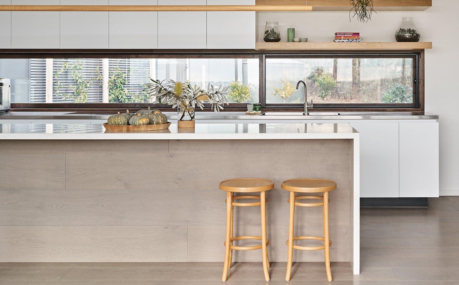 Kitchen, Ceiling Lighting, Medium Hardwood Floor, White Cabinet, Undermount Sink, and Engineered Quartz Counter  The Balnarring Beach House
