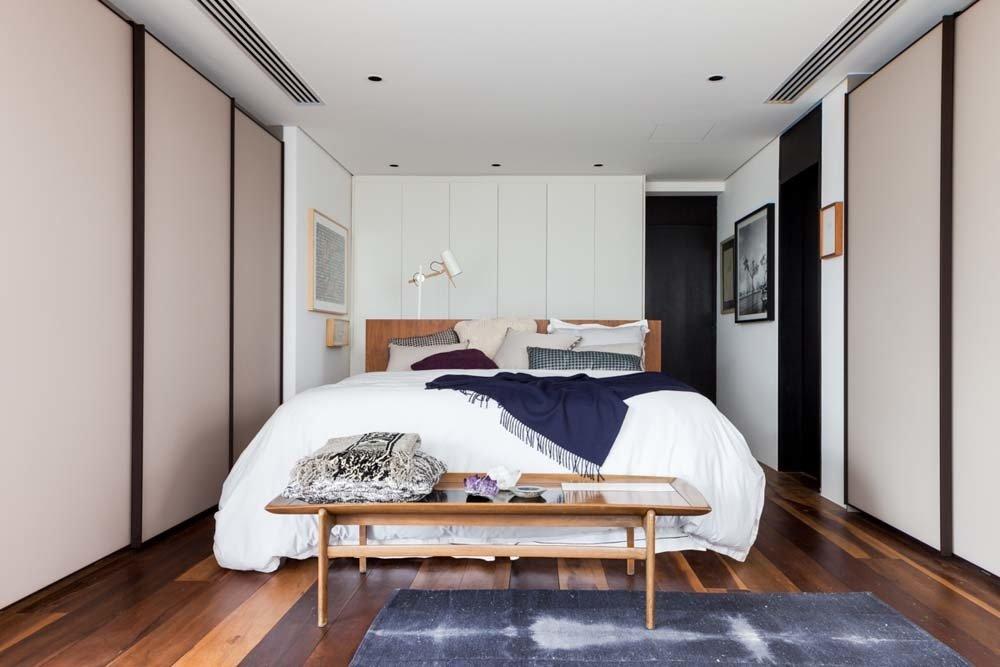 Bedroom, Bed, Dark Hardwood Floor, Pendant Lighting, Ceiling Lighting, and Wardrobe  The Clodomiro Apartment