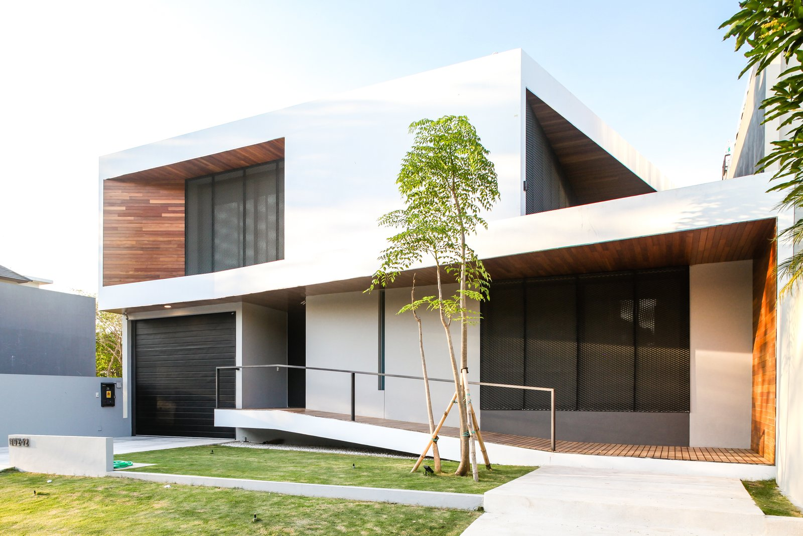 Exterior, Wood Siding Material, House Building Type, Flat RoofLine, Mid-Century Building Type, Stucco Siding Material, and Metal Siding Material  JV House by Ivan Priatman Architecture