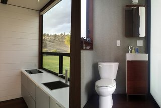 KitHaus modular homes offer modern touches, like sleek, angular designs and vanities made of timber.