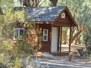 From Oregon Timberwerks comes one of the lowest modular home prices we could find. These adorable log cabins make great options if you're considering a (seriously) tiny home. They're well insulated and fully weatherproof, constructed with solid wood and plywood. The floors are constructed of pressure treated lumber and exterior plywood, and the walls are covered with tapered lap siding over plywood sheathing and a vapor barrier.