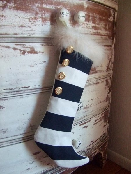 There's no way Santa will miss this eye-catching modern Christmas stocking. With trendy, black-and-white stripes and gold details, it's sure to be a lovely addition to your modern Christmas decor.