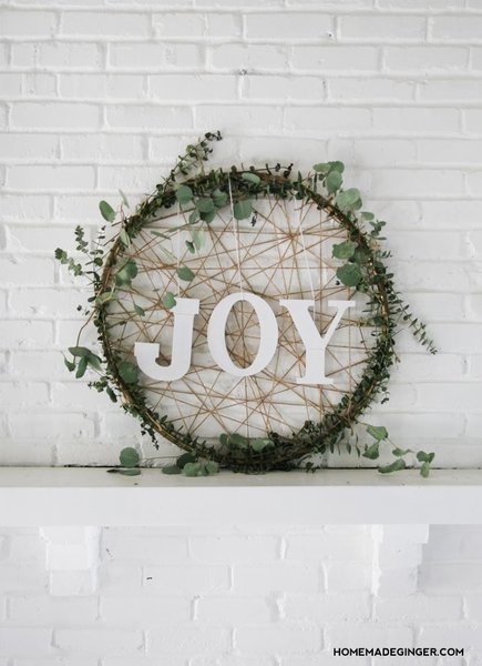 This modern Christmas wreath proclaims the joy of the season while keeping the greenery minimal by using eucalyptus instead of the more traditional pine or holly greens. The twine lends a rustic backdrop for the letters.