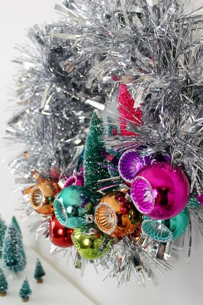 This festive wreath has all the elements of classic midcentury modern Christmas decorations. With a bevy of bright colors and lots of shiny tinsel, it's sure to be the focal point of your modern holiday decor. What's more, it makes for a simple DIY project, too.