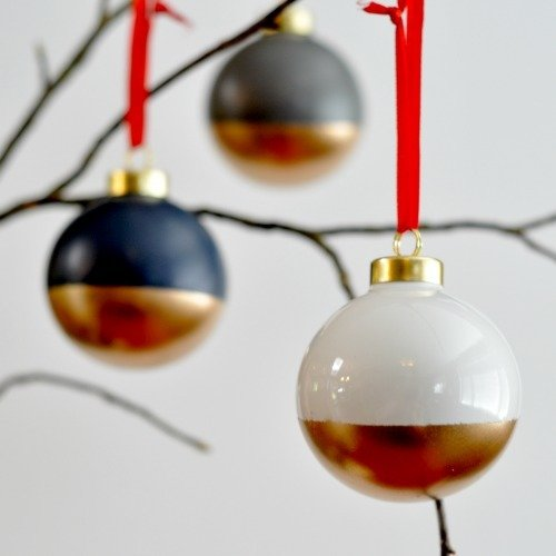 Add a glimmer of gold to your Christmas tree with these modern, two-tone Christmas ornaments. Base colors of trendy black and white give way to timeless gold on these beautiful baubles.