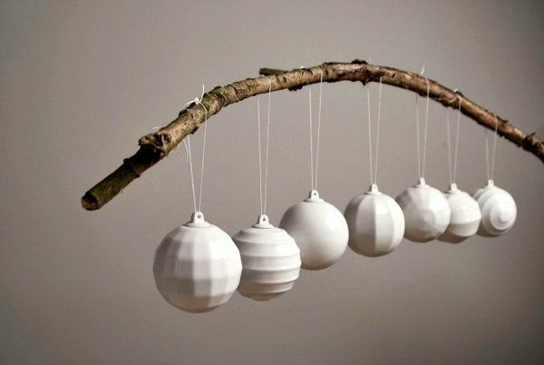 We can't get enough of these modern Christmas ornaments by Czech designer NAJLETO. Handcrafted from white porcelain and shaped with clean lines, this monochromatic set lends a minimalist vibe to your modern Christmas decor.