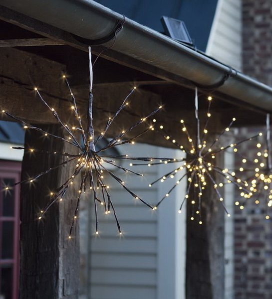 Adorn your rafters with these radiant bursts of light if you're looking for modern Christmas outdoor decor. Tiny twinkling lights are understated and elegant, making your space look elegant rather than overdone.