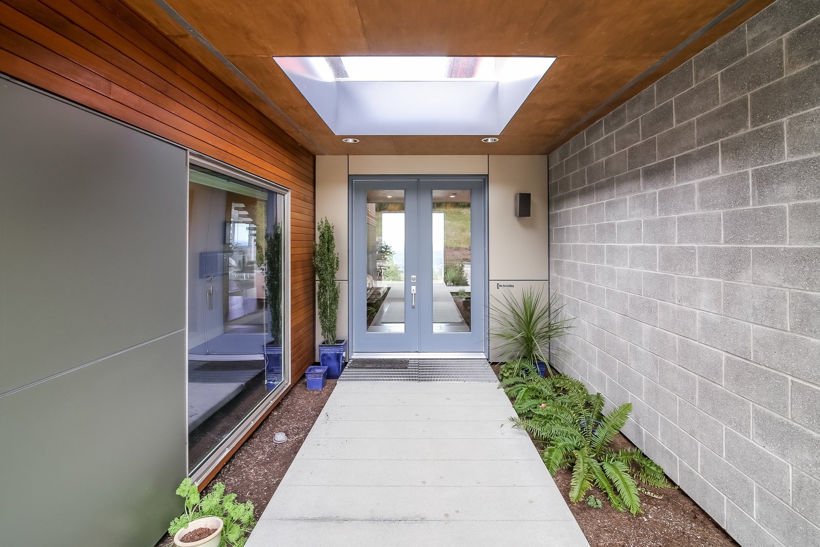 Outdoor, Shrubs, Front Yard, Planters Patio, Porch, Deck, Concrete Patio, Porch, Deck, Wood Patio, Porch, Deck, and Walkways  Japanese Builder Ichijo Creates Net-Zero Energy Home by PlanOmatic