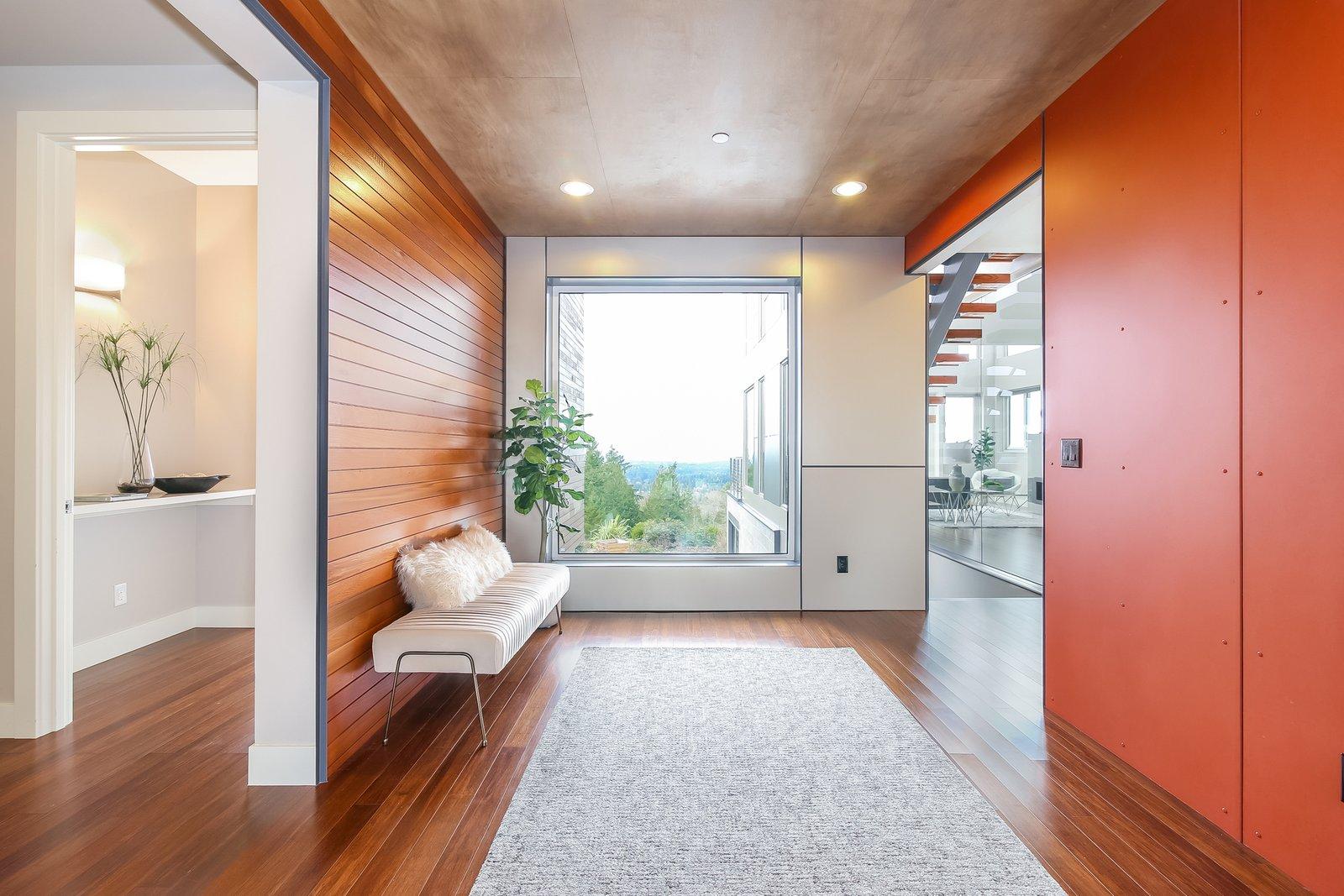 Hallway and Medium Hardwood Floor  Japanese Builder Ichijo Creates Net-Zero Energy Home by PlanOmatic