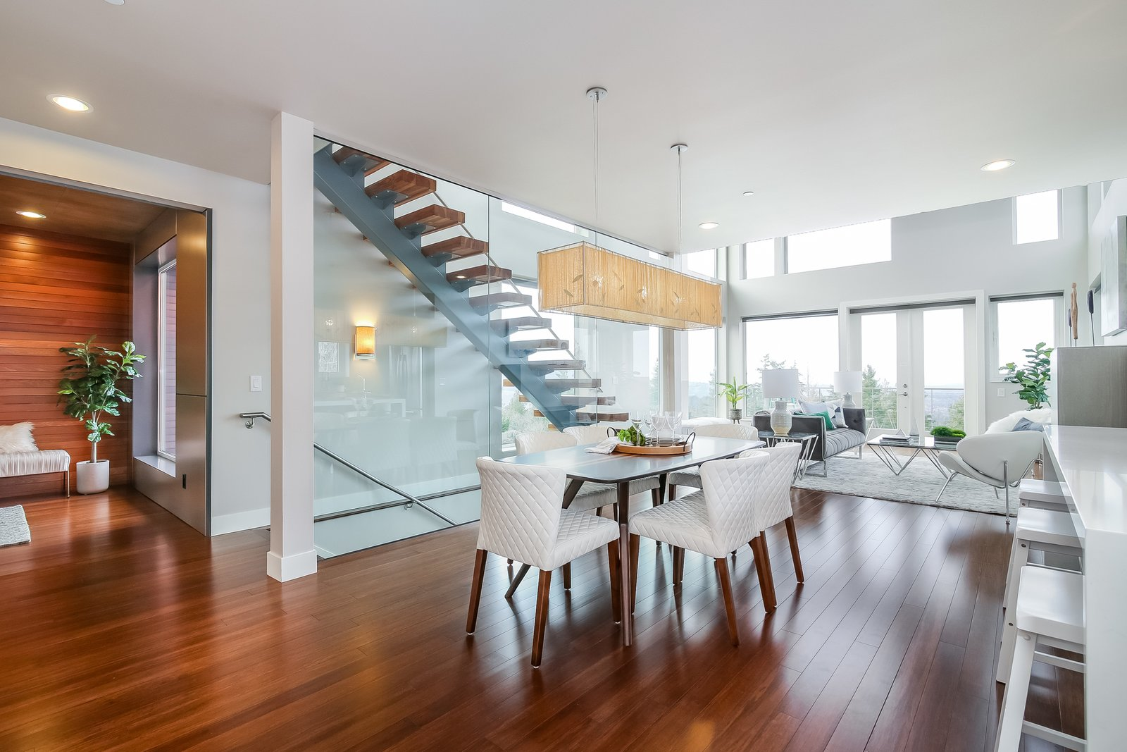 Dining Room, Medium Hardwood Floor, Chair, Bar, Ceiling Lighting, Table, Recessed Lighting, and Wall Lighting  Japanese Builder Ichijo Creates Net-Zero Energy Home by PlanOmatic