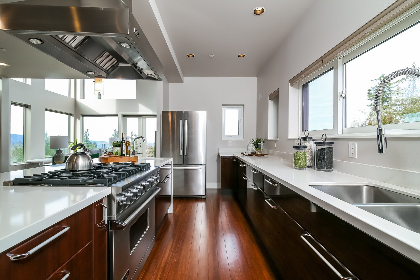 Kitchen, Range Hood, Wood Cabinet, Cooktops, Vessel Sink, Range, Marble Counter, Refrigerator, and Ceiling Lighting  Japanese Builder Ichijo Creates Net-Zero Energy Home by PlanOmatic