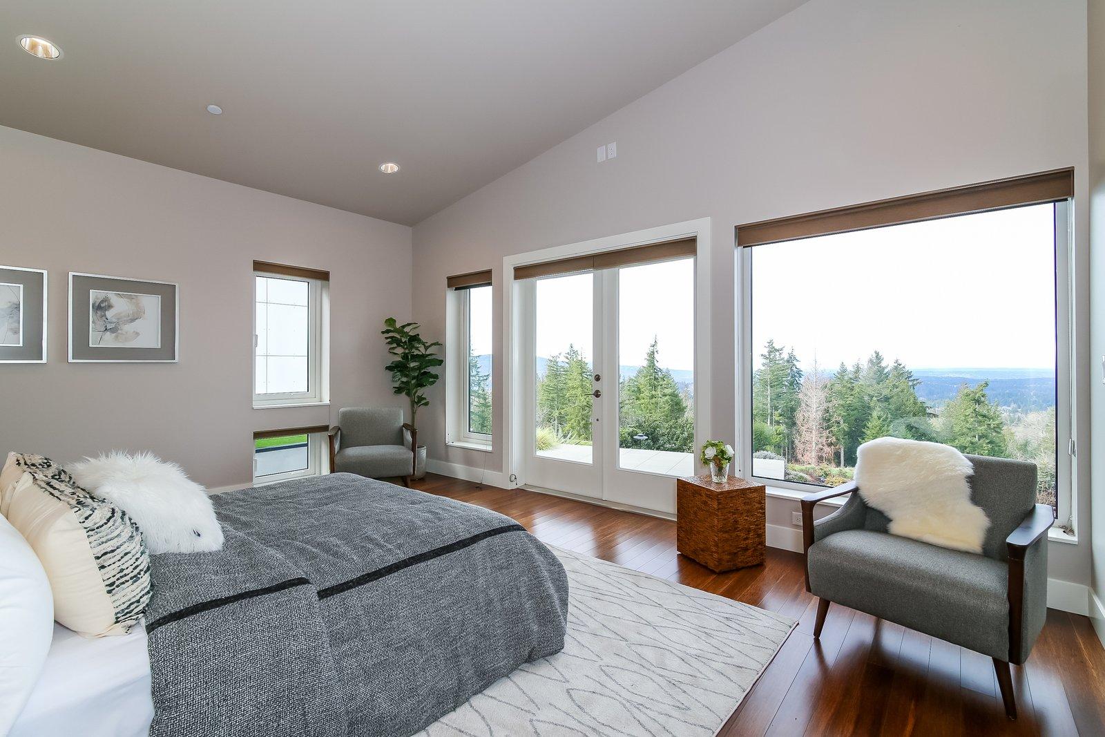 Bedroom, Chair, Ceiling Lighting, Bed, and Medium Hardwood Floor  Japanese Builder Ichijo Creates Net-Zero Energy Home by PlanOmatic