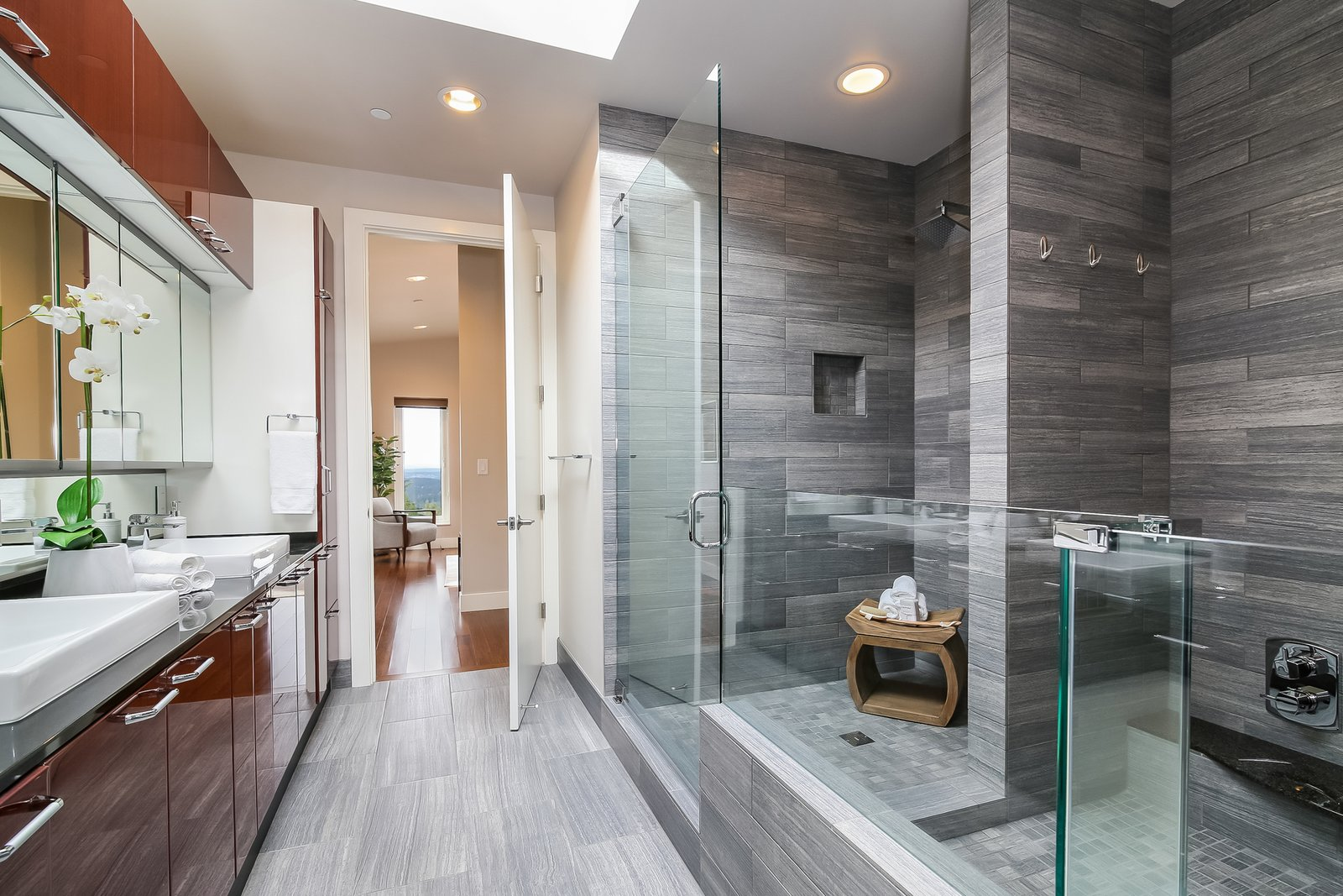 Bath Room, One Piece Toilet, Open Shower, Quartzite Counter, Cement Tile Floor, Stone Tile Wall, Vessel Sink, Full Shower, and Ceiling Lighting  Japanese Builder Ichijo Creates Net-Zero Energy Home by PlanOmatic