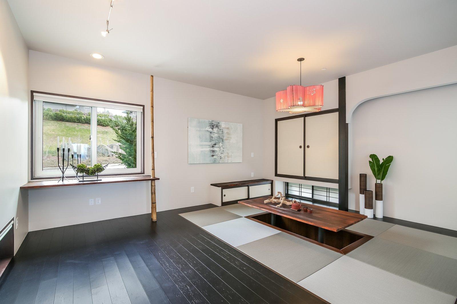 Living Room, Dark Hardwood Floor, and Pendant Lighting  Japanese Builder Ichijo Creates Net-Zero Energy Home by PlanOmatic