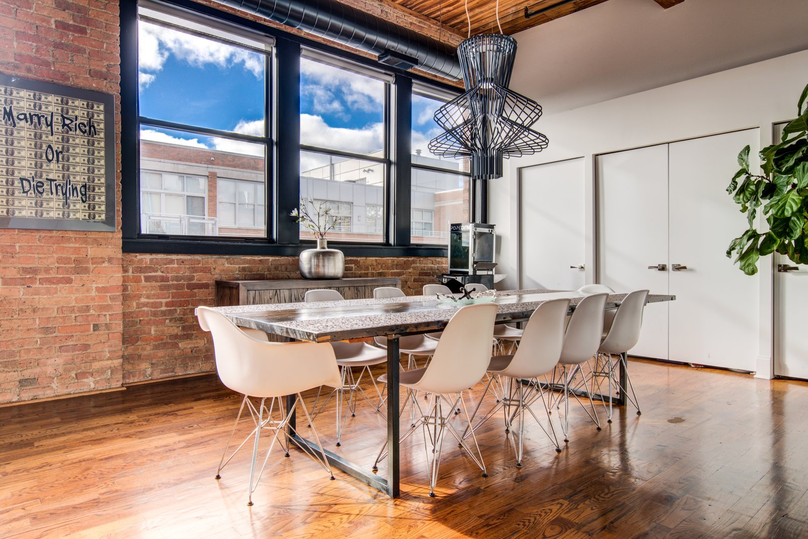 Dining Room, Medium Hardwood Floor, Track Lighting, Chair, Table, and Ceiling Lighting  Penthouse That Starred on NBC's 'Chicago Fire' Asks $1.775M
