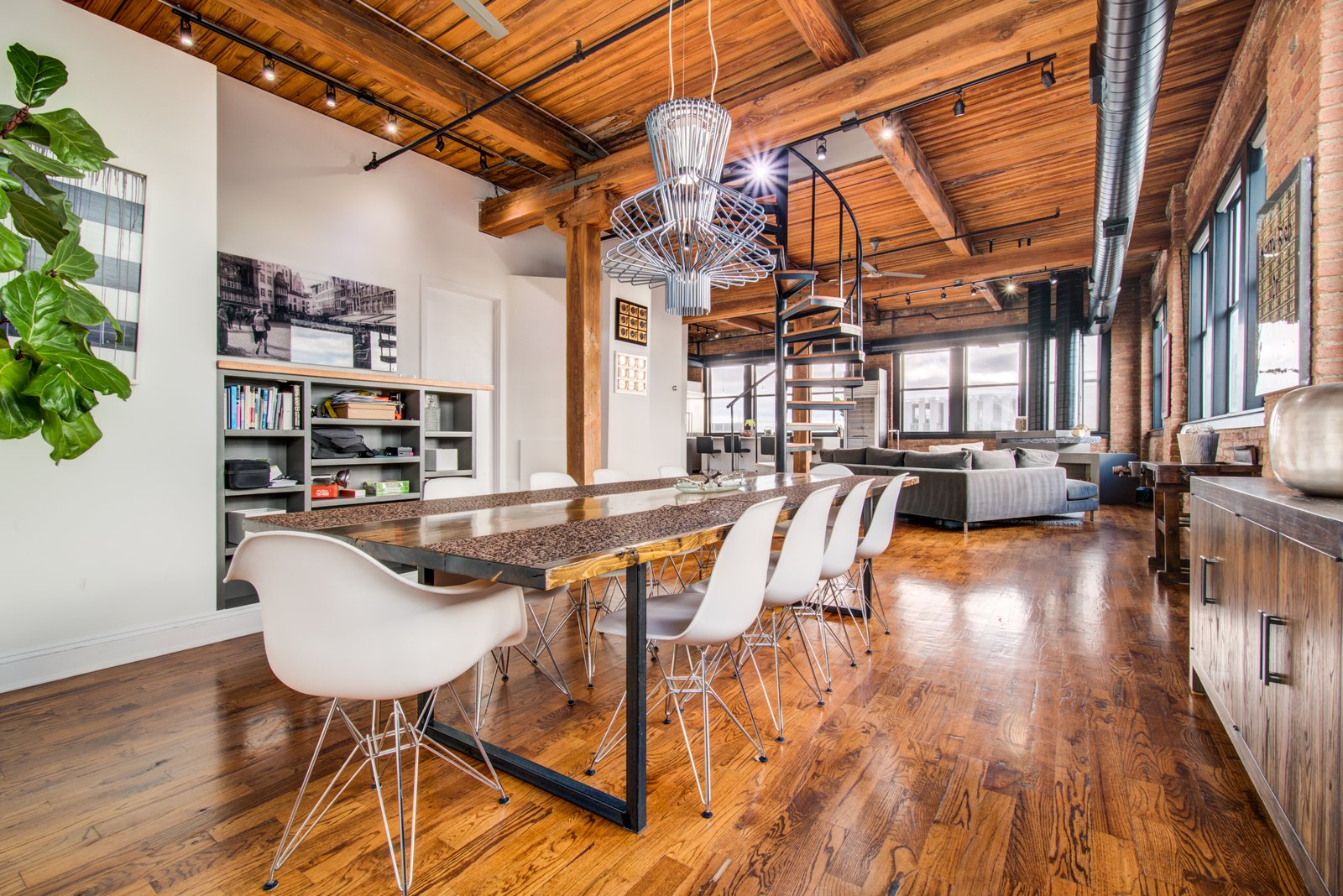 Dining Room, Chair, Ceiling Lighting, Shelves, Table, Medium Hardwood Floor, and Track Lighting  Penthouse That Starred on NBC's 'Chicago Fire' Asks $1.775M