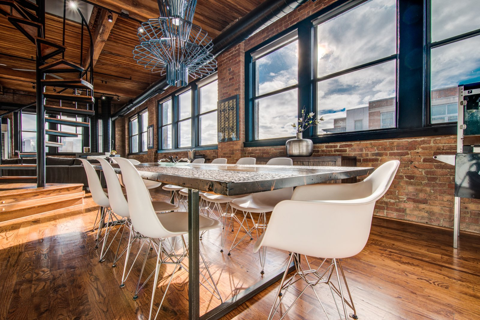 Dining Room, Track Lighting, Medium Hardwood Floor, Chair, Ceiling Lighting, and Table  Penthouse That Starred on NBC's 'Chicago Fire' Asks $1.775M