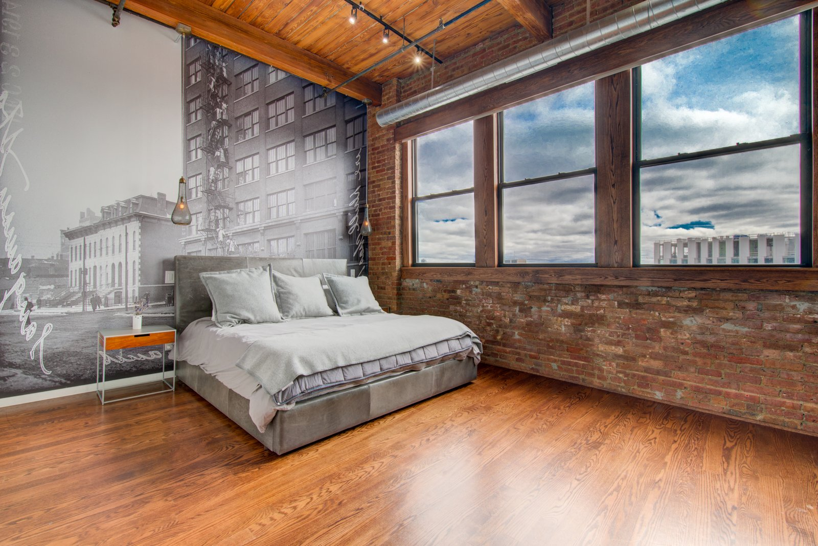 Bedroom, Track Lighting, Night Stands, Bed, Medium Hardwood Floor, and Ceiling Lighting  Penthouse That Starred on NBC's 'Chicago Fire' Asks $1.775M