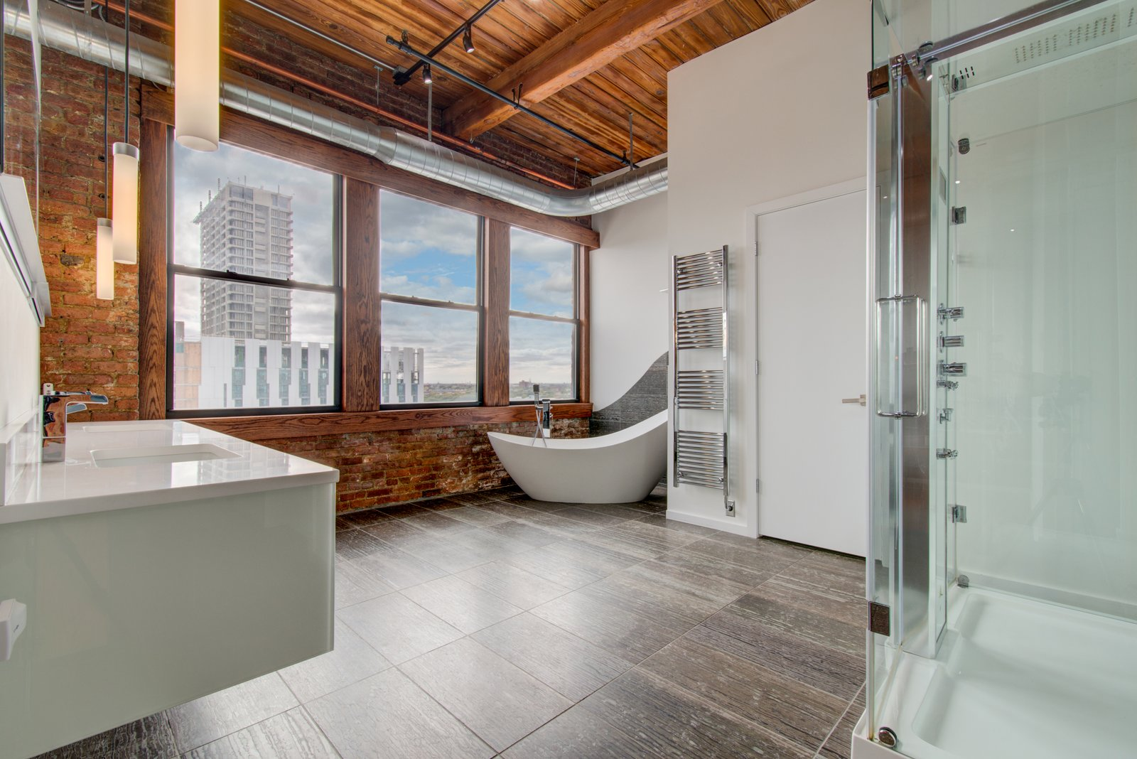 Bath Room, Freestanding Tub, Track Lighting, Soaking Tub, Ceiling Lighting, and Quartzite Counter  Penthouse That Starred on NBC's 'Chicago Fire' Asks $1.775M