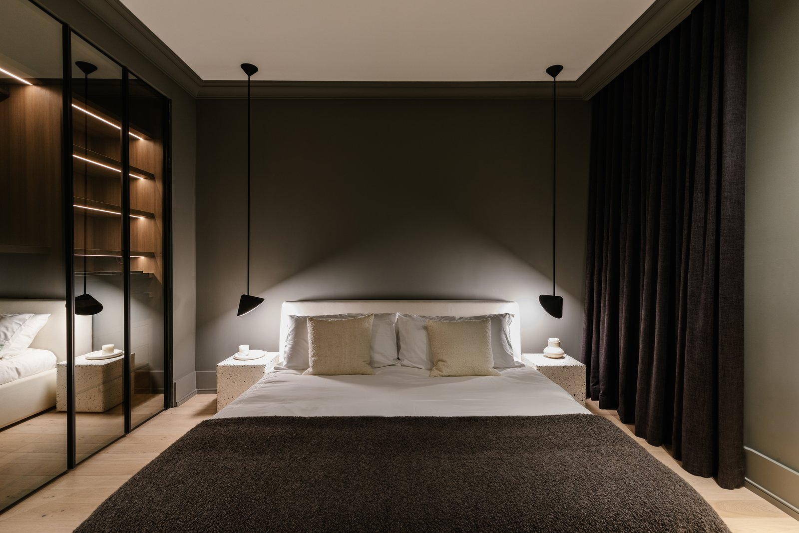 Bedroom, Accent Lighting, Lamps, Storage, Pendant Lighting, Shelves, Night Stands, Bed, Ceiling Lighting, and Light Hardwood Floor  The Adelaide Project
