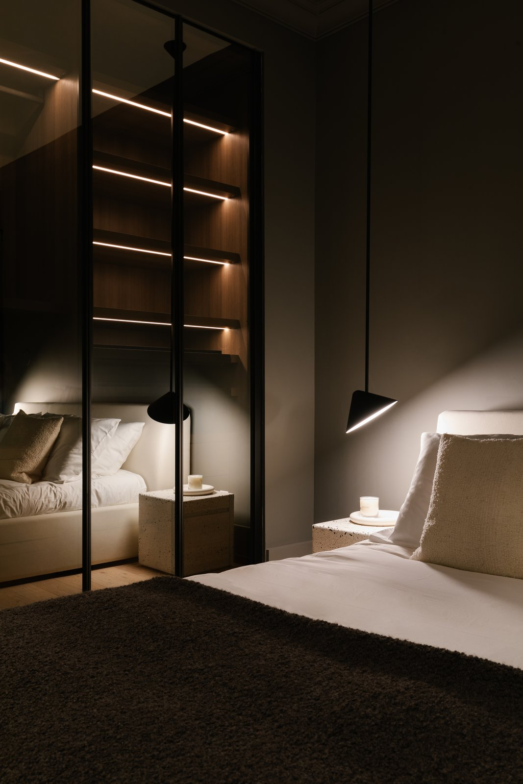 Bedroom, Recessed Lighting, Shelves, Bed, Lamps, Pendant Lighting, Night Stands, Light Hardwood Floor, Accent Lighting, and Storage  The Adelaide Project