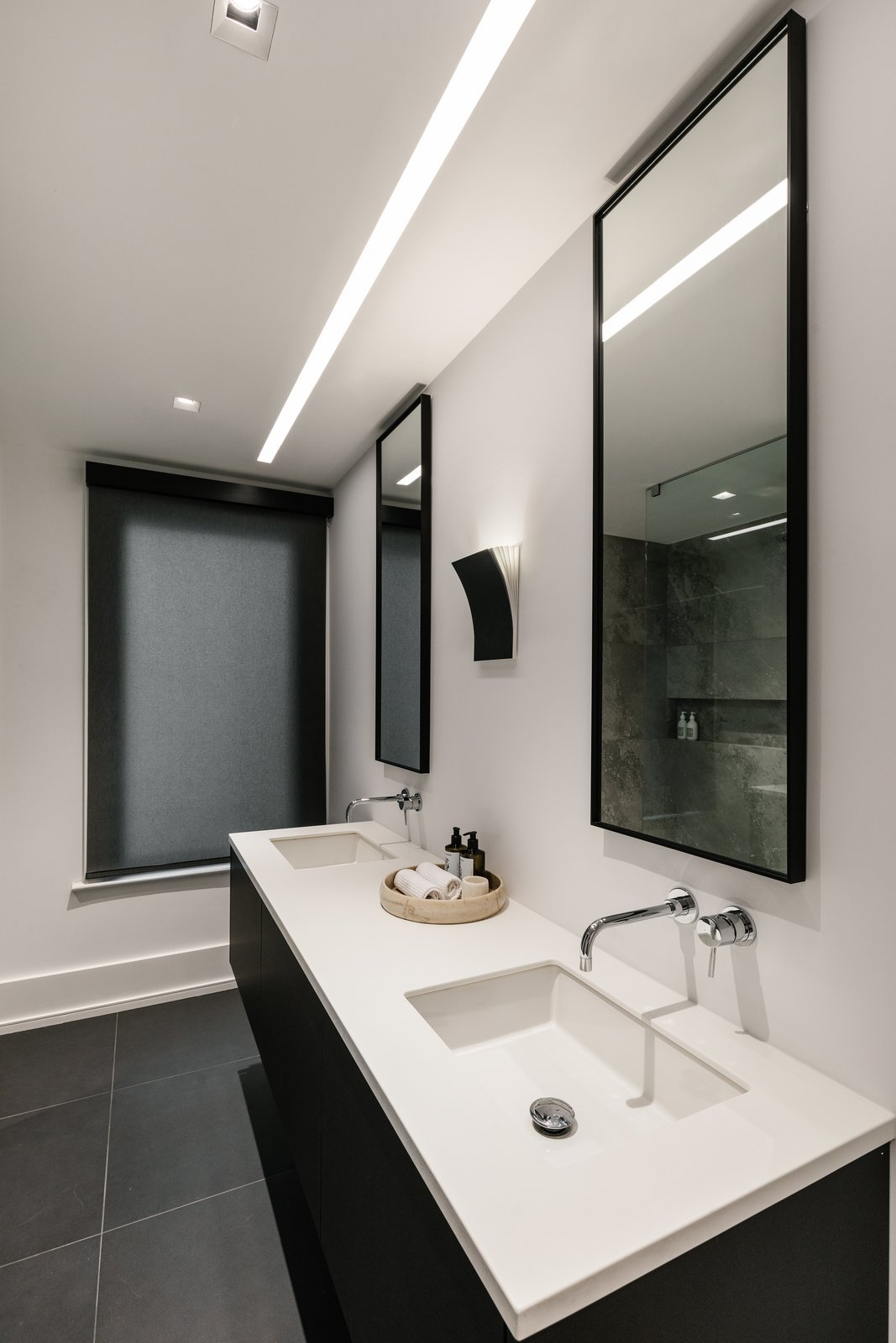Bath Room, Quartzite Counter, Undermount Sink, Ceiling Lighting, Ceramic Tile Floor, Wall Lighting, Accent Lighting, Track Lighting, and Recessed Lighting  The Adelaide Project