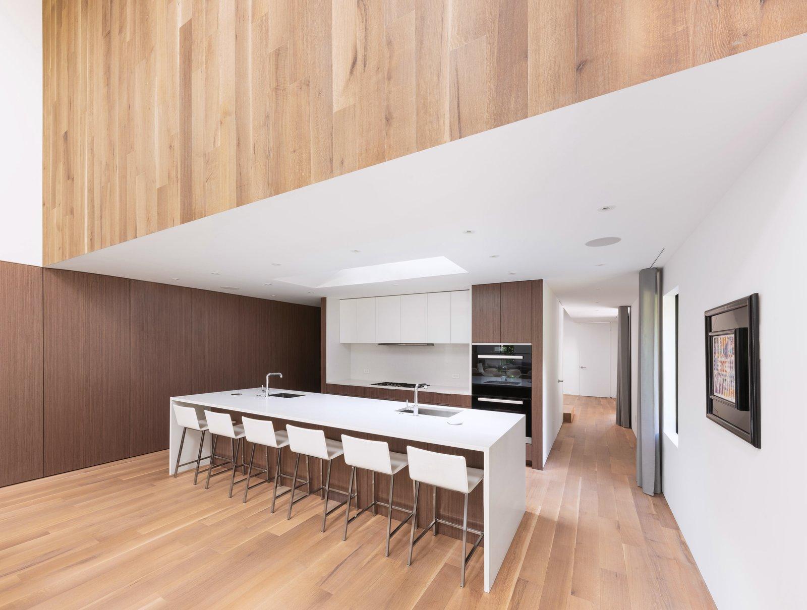 Kitchen, Undermount, Wall Oven, Recessed, Wood, Ceiling, Light Hardwood, and Engineered Quartz  Best Kitchen Wall Oven Wood Undermount Recessed Engineered Quartz Photos from Split Box House