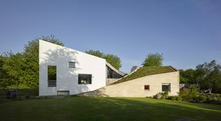 A Bold, Green-Roofed Home Sprouts on the Edge of a Rural English Village