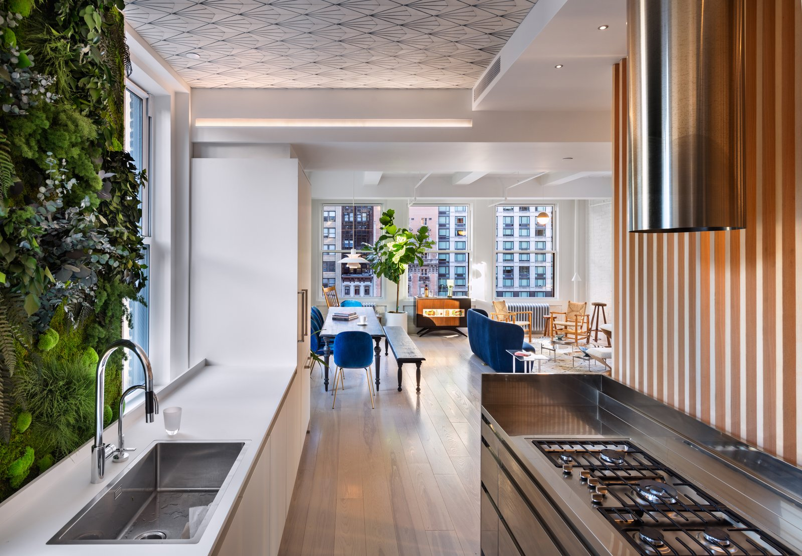 Kitchen, Light Hardwood, Wood, Ceiling, Range, Range Hood, and Drop In  Best Kitchen Wood Range Hood Photos from Empire State Apartment