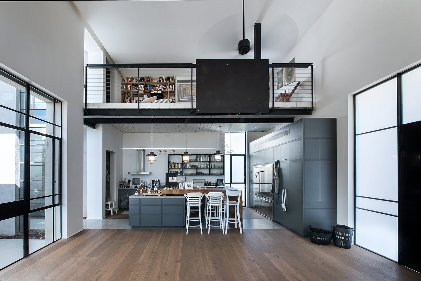 Kitchen, Microwave, Refrigerator, Range Hood, Cooktops, Medium Hardwood, Dishwasher, Wall Oven, Concrete, Ceiling, Concrete, Wine Cooler, Range, and Colorful  Best Kitchen Microwave Range Hood Ceiling Cooktops Colorful Photos from savion house