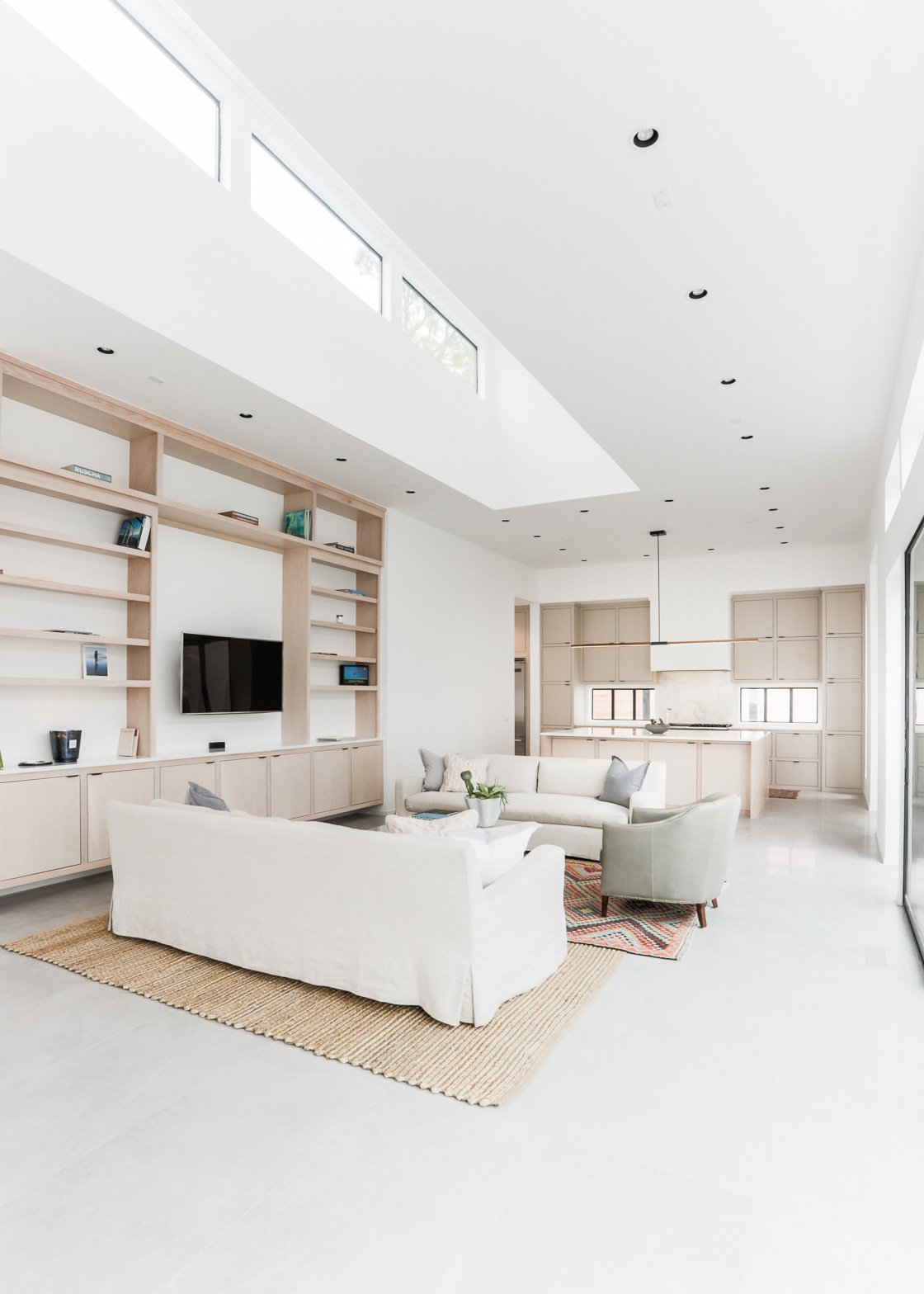 Living Room, Sofa, Chair, Bookcase, and Recessed Lighting  OKC Modern by Emily  Hart