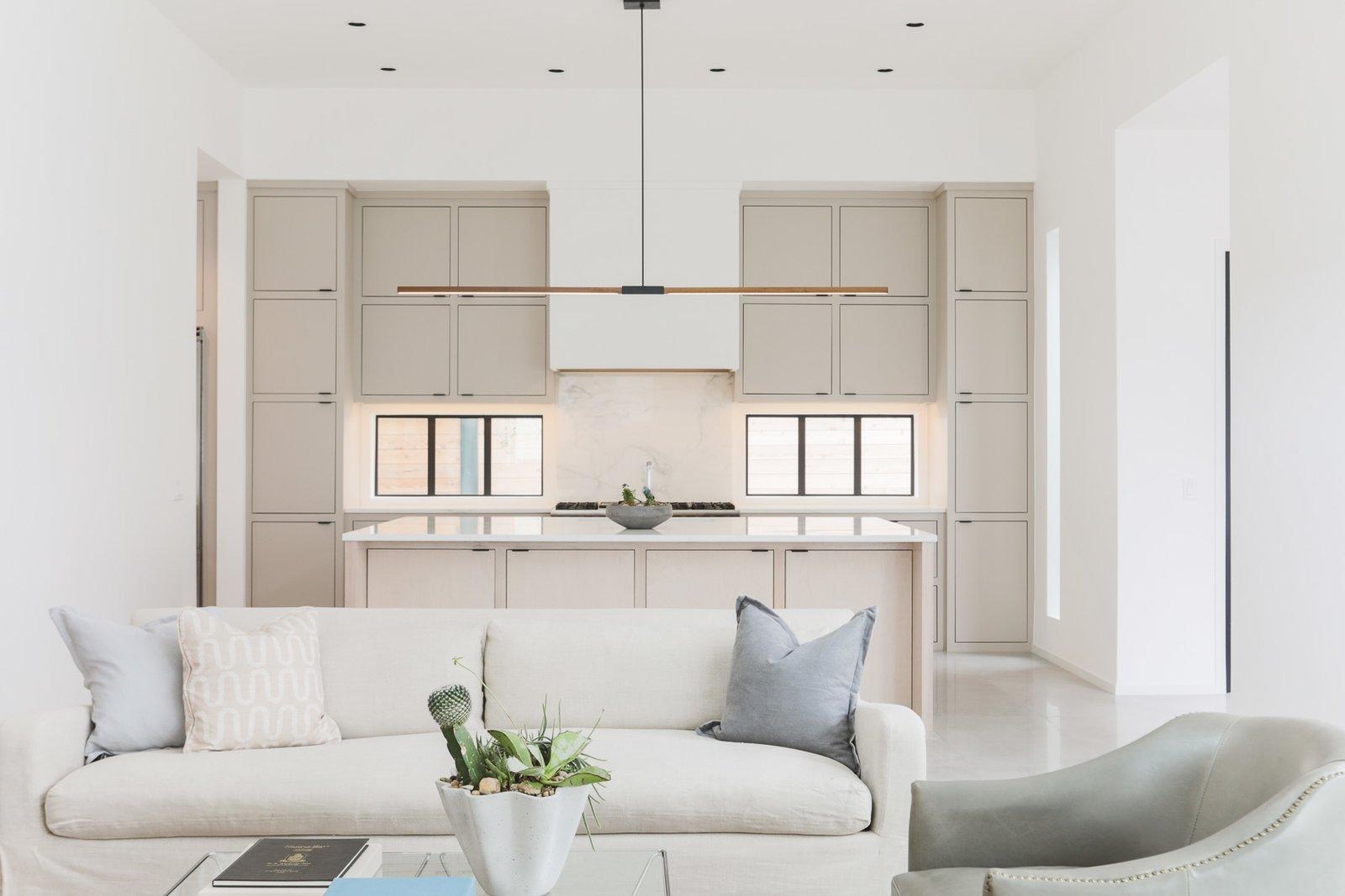 Kitchen, Marble Counter, Marble Backsplashe, Wood Cabinet, and Pendant Lighting  OKC Modern by Emily  Hart