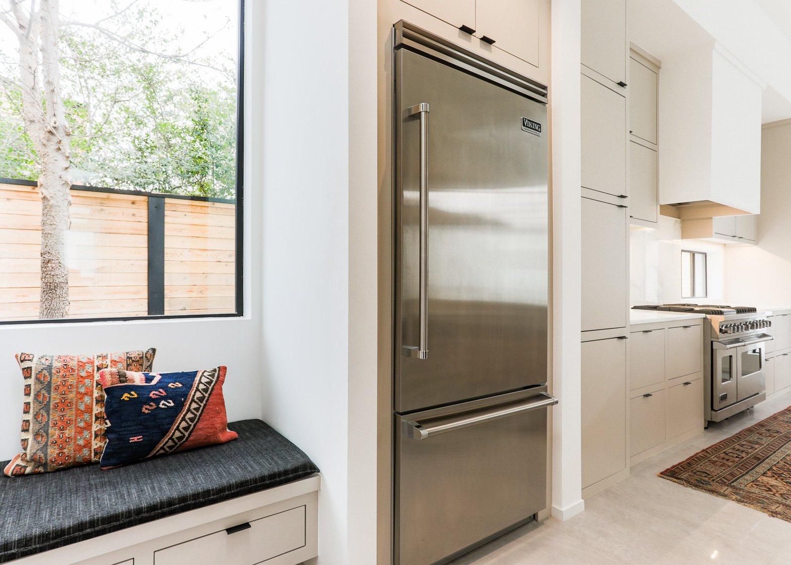 Kitchen, Wood Cabinet, Range, Marble Backsplashe, Marble Counter, and Refrigerator  OKC Modern by Emily  Hart