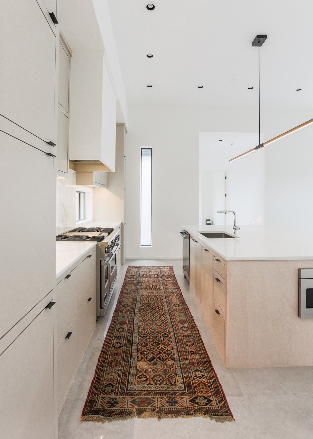Kitchen, Microwave, Wood Cabinet, Pendant Lighting, and Range  OKC Modern by Emily  Hart