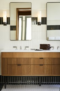 Gleaming, warm baths feature productsinspired by T.B. Rayl's, one of the building's previous occupants.