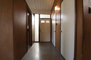 Before: The original corridor felt dark and cramped.