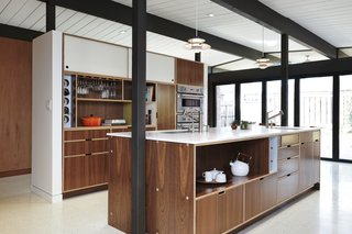 """For the new kitchen, which was rotated perpendicularly to improve circulation, interior designer Pamela Lin-Tam opted for """"interior finishes that reflect the time period, but don't feel old or outdated,"""" says architect Megan Blaine. Modular cabinets are paired with quartz countertops."""