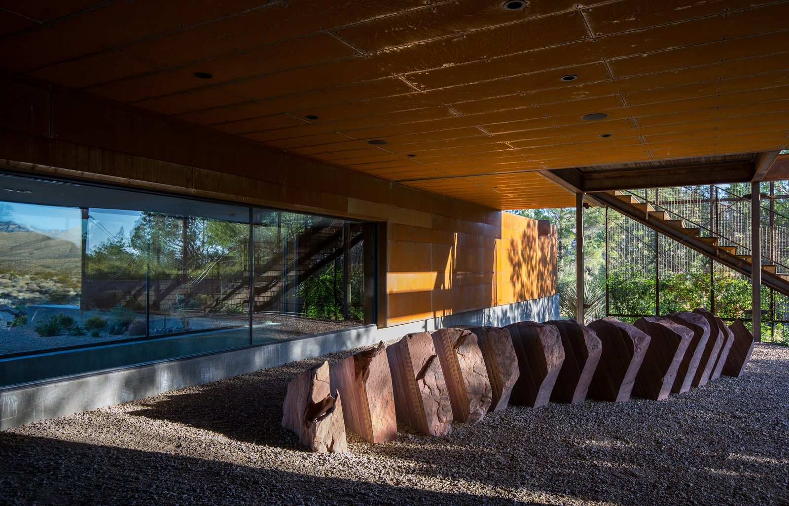 Outdoor, Decomposed Granite Patio, Porch, Deck, Boulders, Metal Fences, Wall, Concrete Fences, Wall, Front Yard, Walkways, Gardens, and Concrete Patio, Porch, Deck  minMAX by Punch Architecture