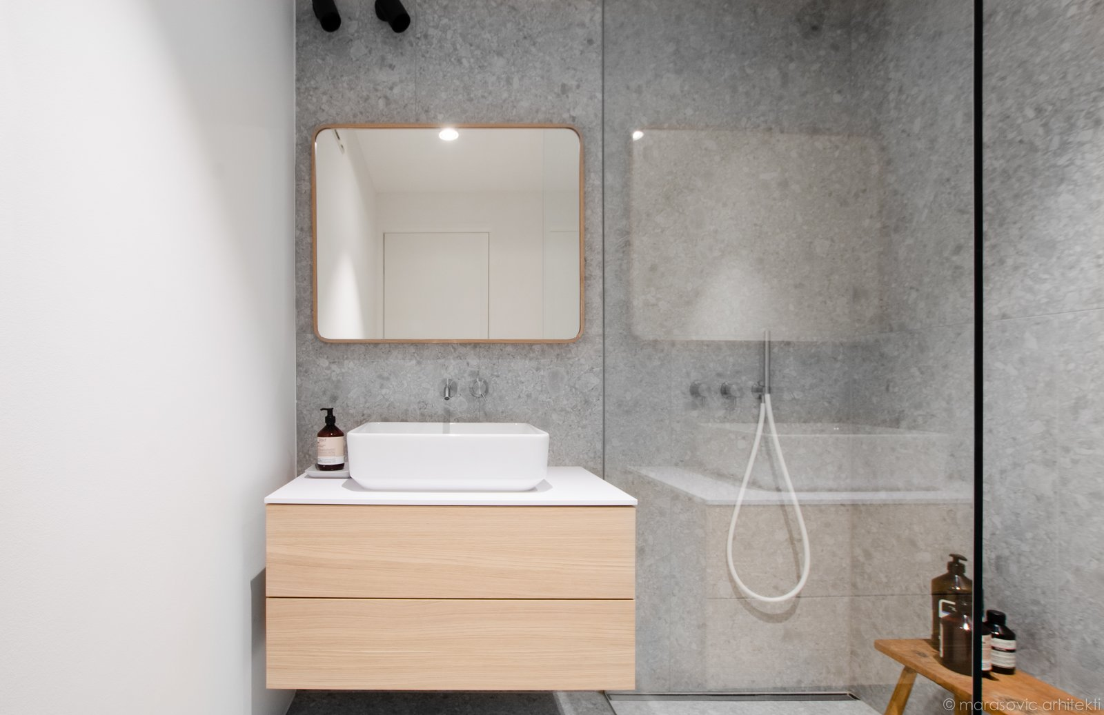 Bath Room, Wall Lighting, Pedestal Sink, Open Shower, Undermount Tub, Laminate Counter, Ceramic Tile Floor, and Terrazzo Floor  Best Photos from Apartment M8