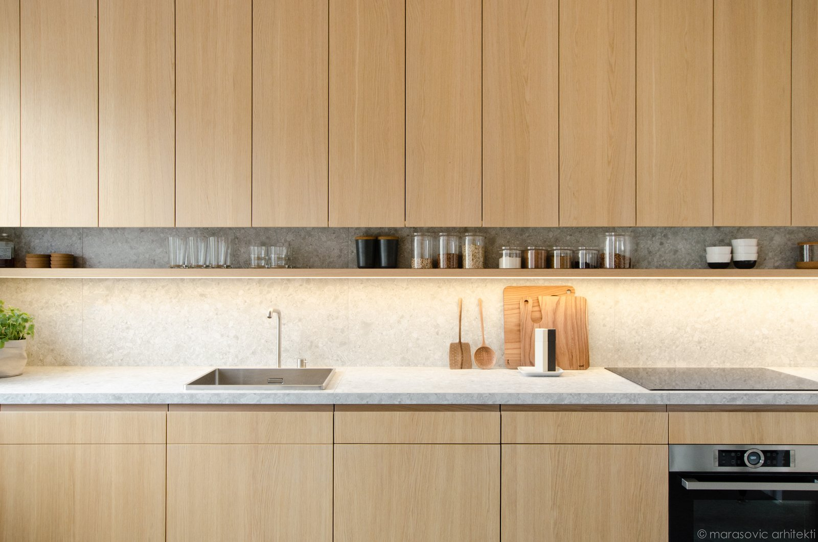 Kitchen, Wood Cabinet, Stone Counter, Cooktops, and Drop In Sink  Best Photos from Apartment M8