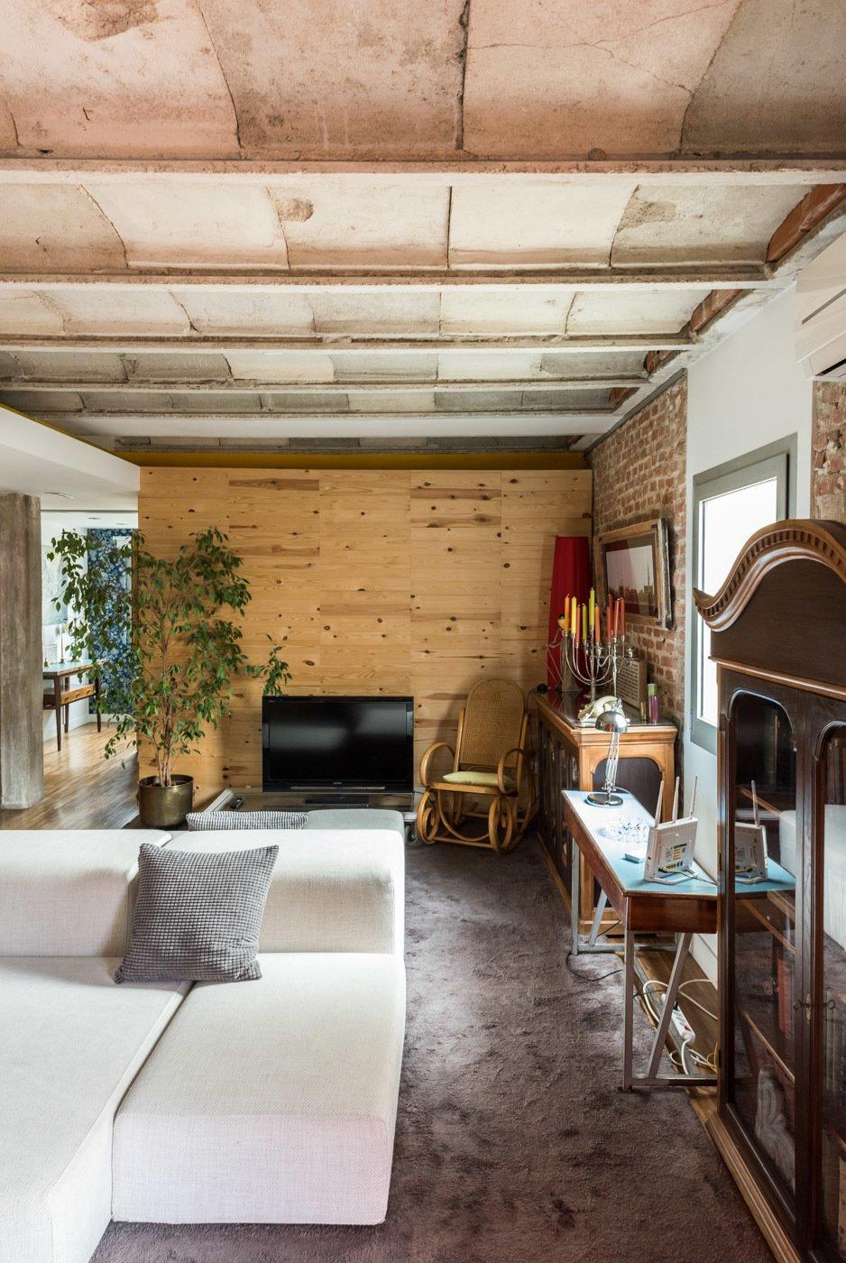 Living Room, Sofa, Medium Hardwood Floor, Console Tables, and Ceiling Lighting  Echávarri house 100m2. Loft between gardens.