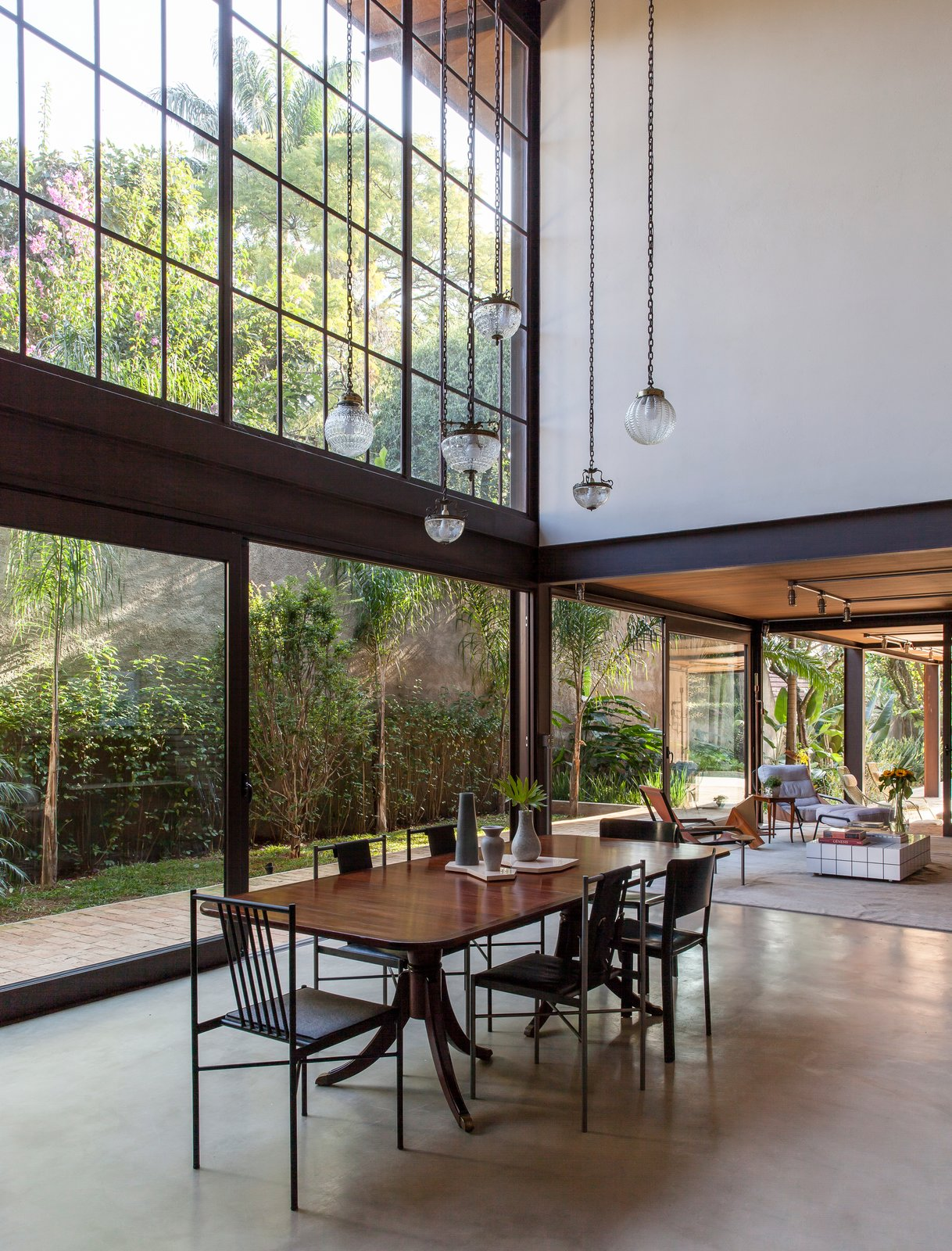 Dining Room, Pendant Lighting, Lamps, Chair, Table, and Concrete Floor  Conde D'eu House
