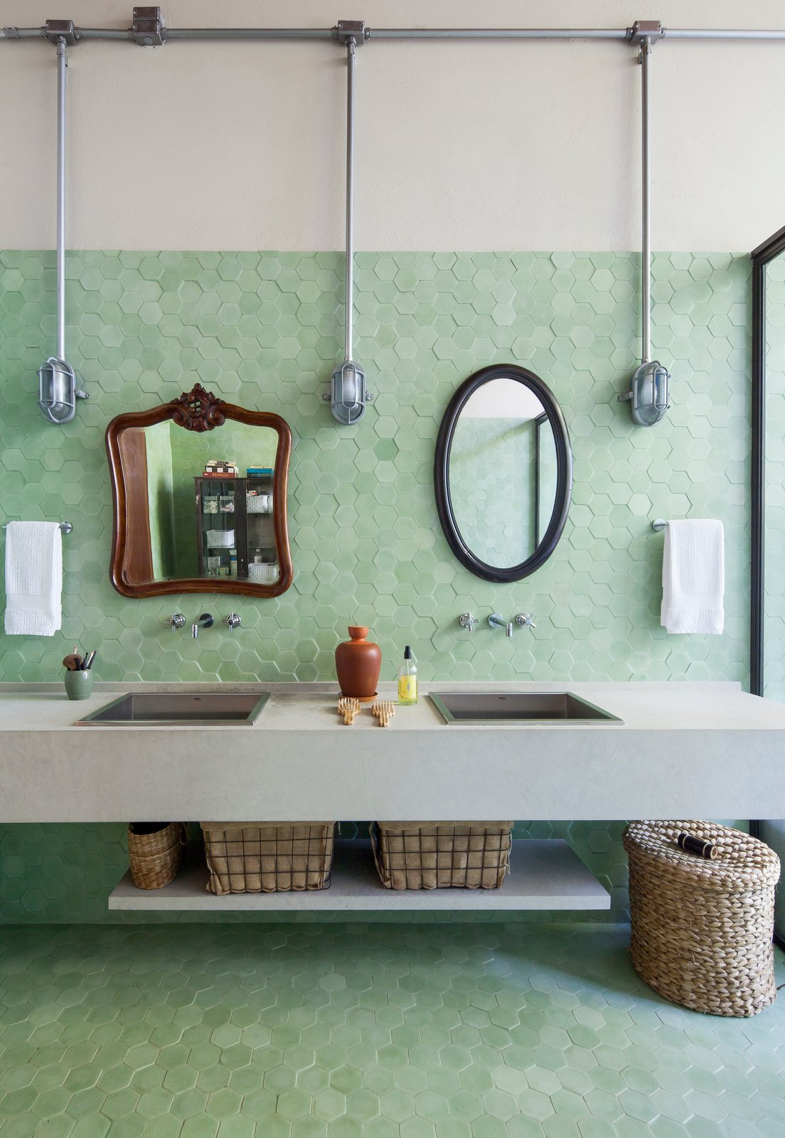 Bath Room, Wall Lighting, Wall Mount Sink, Mosaic Tile Wall, Porcelain Tile Floor, One Piece Toilet, Stone Counter, Ceramic Tile Wall, Porcelain Tile Wall, and Enclosed Shower  Conde D'eu House