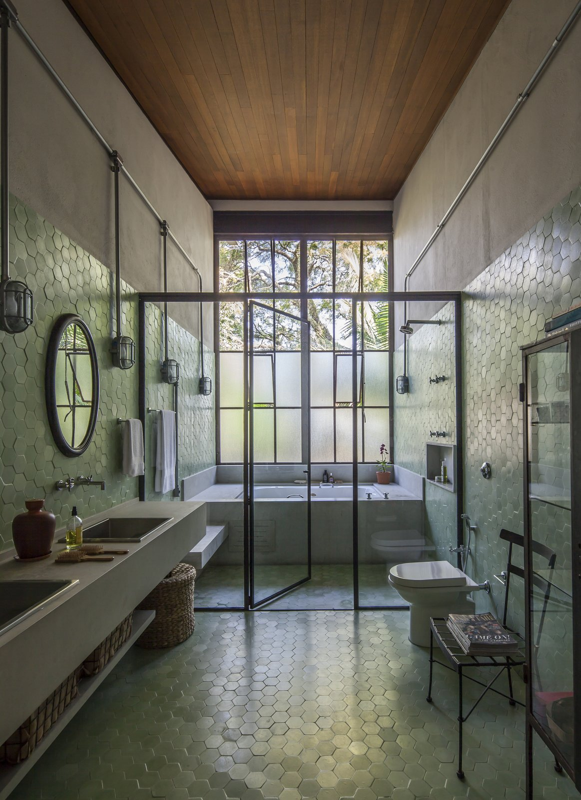 Bath Room, Ceramic Tile Floor, Enclosed Shower, One Piece Toilet, Wall Mount Sink, Wall Lighting, and Mosaic Tile Wall  Conde D'eu House