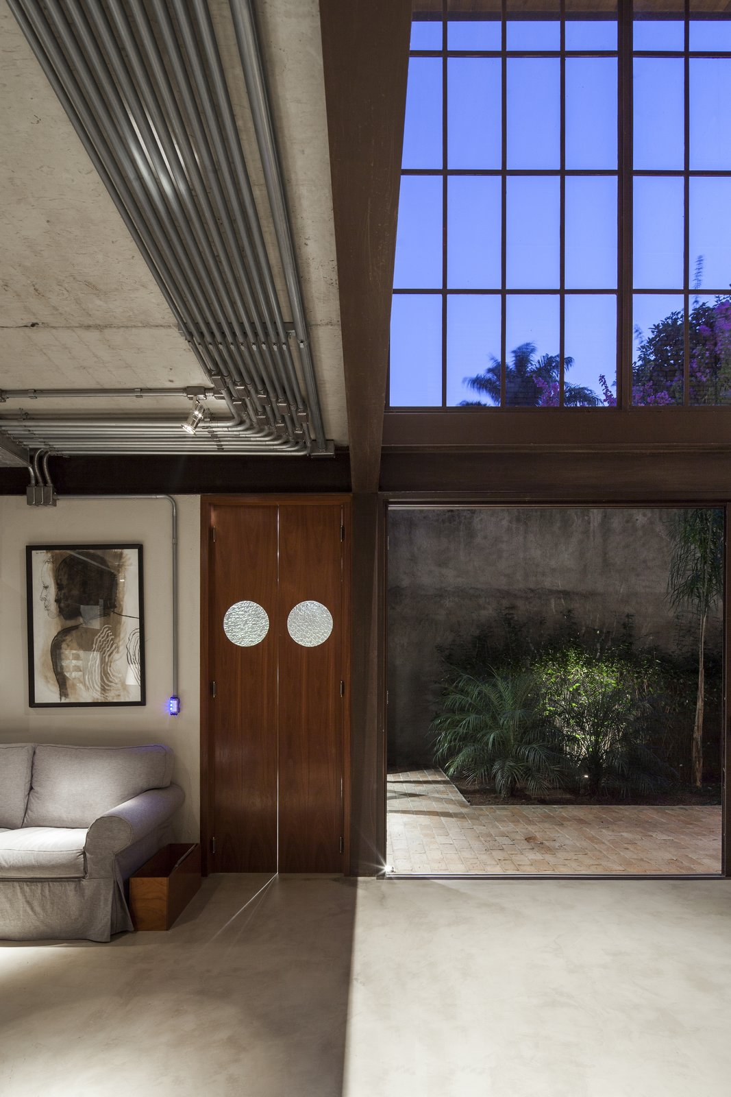 Living Room, Ceiling Lighting, Sofa, Concrete Floor, and Lamps  Best Photos from Conde D'eu House