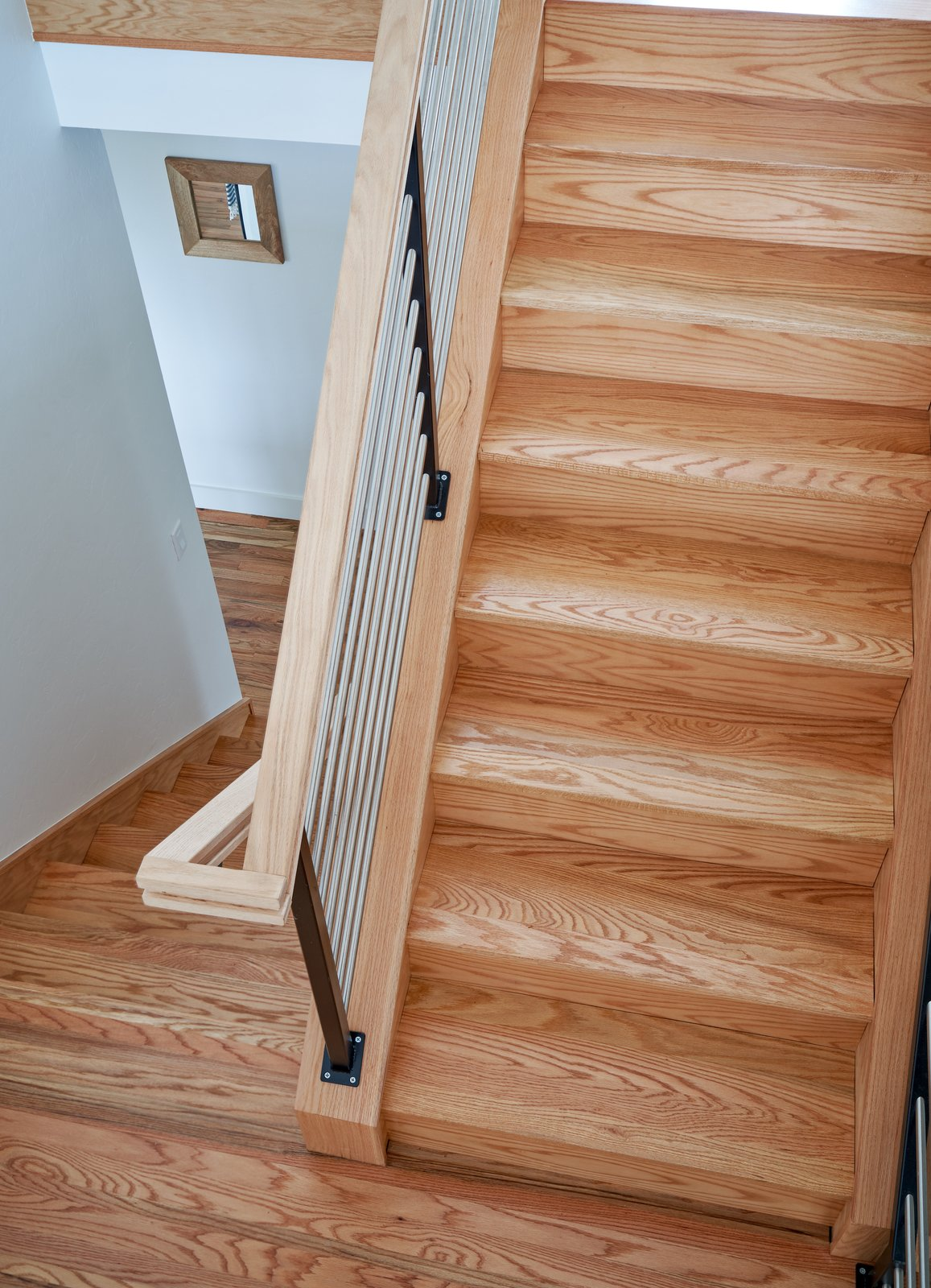 Staircase, Metal Railing, Wood Railing, and Wood Tread Stair  OKC Farmhouse by Scharbach Workshop