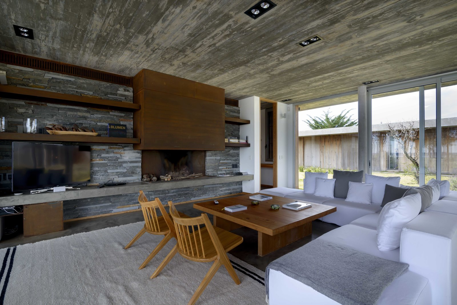 Living Room, Ceiling Lighting, Sofa, Wood Burning Fireplace, Coffee Tables, and Chair  Rückenwind